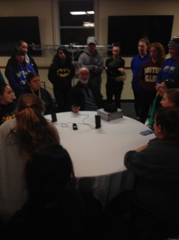 Ghost Hunter John Zaffis and UNE Students talking  to ghosts in Sutton Lounge