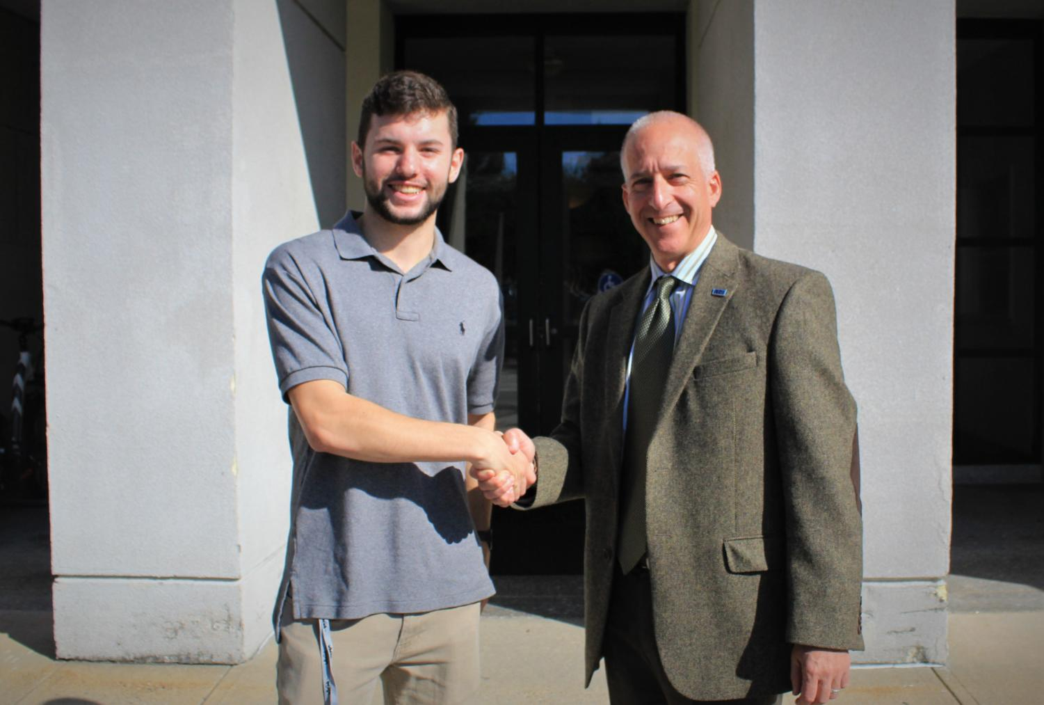 Editor-In-Chief Jack Allsopp (Left) shaking hands with Dean Jonathan Millen (right)
