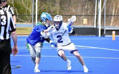 Senior captain #2 Garett Bozek against Salve Regina during a late season matchup last spring.