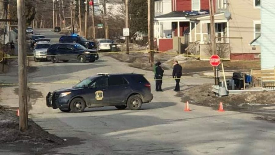 Police outside the Summer St. home investigate the shooting of a young girl. From https://wgme.com/news/local/police-shut-down-waterville-intersection
